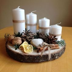 Cheap and Easy Christmas Centerpiece Ideas that you can Make in a Jiff - Hike n Dip Thinking about easy and cheap christmas centerpiece ideas that you can do by yourself? Look here for some of the easiest Christmas centerpiece ideas. Christmas Advent Wreath, Christmas Candle Decorations, Cheap Christmas, Noel Christmas, Christmas Candles, Modern Christmas, Rustic Christmas, Simple Christmas, Christmas Greetings
