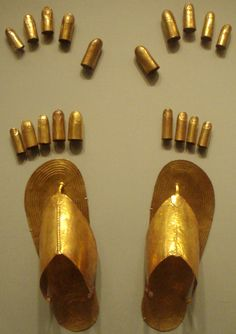 Egyptian Sheet gold finger and toe coverings, plus sandals, from the tomb of  three minor wives of Thutmose III at Wady Gabbanat el-Qurud, circa  1479-1425B.C. On display at the Metropolitan Museum of Art.