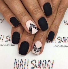 Black and blush nails with geometric tribal nail art