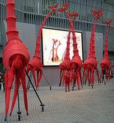 "These 8 meter tall mechanical giraffes that are operated like puppets is readying for one of the best street performances that I've ever witnessed.  ""Les Giraffes"" street performance festival held in Roppongi Hills, Tokyo. © Photo by Harry Maison a.k.a BlackManInJapan ""JAPAN'S STREET PHOTOGRAPHER EXTRAORDINAIRE"""