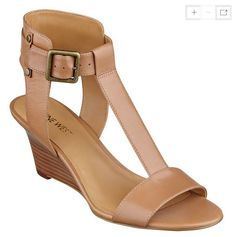 It's definitely time for a pedi. Our Rileigh wedge sandals feature an open-toe and T-strap. Adjustable buckle closure for a snug fit. Padded footbed for all-day comfort. Man-made sole. Nude Wedges, Nine West Shoes, Natural Leather, T Strap, Comfortable Shoes, Snug Fit, Wedge Sandals, Open Toe, Footwear