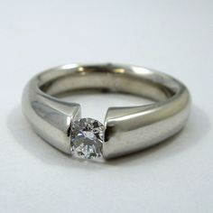 0.35 Carat Round Cut Tension Set Diamond Engagement Ring. SI1 Clarity & F Color. Set in 14K White Gold. AGS Certified.  $1350