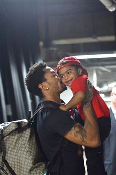 Derrick Rose of the Chicago Bulls gives his son P.J. a kiss