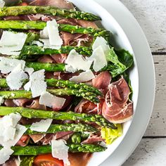 Light and healthy salad with asparagus, serrano ham, manchego cheese and tomatoes in honey – tarragon sauce.
