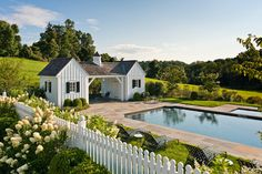 Love the little pool house cottages, picket fence & of course the pool ~ from ThingsWeLove:White Picket Fences