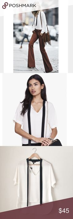 Express SHORT Sleeve Tie Front Blouse Express Short Sleeve Tie Front Blouse in ivory/black. The soft look of the ribbon-tie neckline against this semi-sheer, elegantly draped blouse is office chic. Add a simple bangle, smooth 'do and pencil skirt for a look that's pure polish. Tie closure neckline Short sleeves Semi-sheer crepe, draping fit Hi lo hem Polyester Machine wash cold, gentle cycle Size Small. NWT. Express Tops Blouses