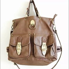 Olivia & Joy Crossbody Large Leather Tote Bag Very good condition, very sturdy, and expensive looking bag. Good quality material. Perfect for a school bag! Olivia + Joy Bags Crossbody Bags