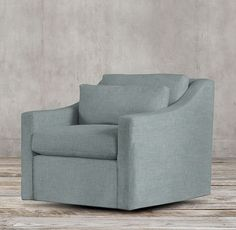 RH's Belgian Classic Slope Arm Upholstered Swivel Chair:A classic interpretation of the European-inspired slope arm sofa. Low to the ground, deep in profile and sleekly streamlined for casual yet sophisticated appeal, it offers luxurious comfort.
