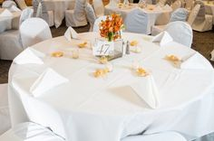 Orange and White Wedding Reception Table Setting