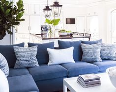 LOVE the color of the sofa, and love it against the white. Bright, cool, beachy.