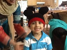 My baby wearing a crocheted Mickey Mouse beanie made by Neemami!