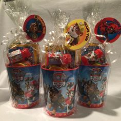 "Paw Patrol Party Favors • hard plastic cups ($.69@Christmas Tree Shops) • Crayola crayons (Amazon for about $.70/ea.) • Paw Patrol mini activity book (Party City for $.10/ea) • Mini play-doh (10 pack for $4.99 @ Christmas Tree Shops) • Mini Paw Patrol bubbles (Party City for $.15/ea) All wrapped in cellophane with a little white curling ribbon with a ""lollipop"" tag printed from NickJr. for free Great for ages 2-7 or so."