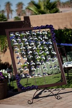 like the idea of the place cards hanging on this, and we could make ourselves! YAY