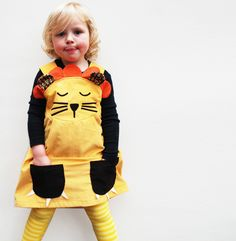 I LOVE all of the dresses in the Etsy shop Wild Things Dresses! ~Girls lion dress. $60.00, via Etsy.