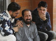 Relatives of a student, who was injured during the attack, comfort each other outside Lady...