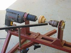 "Wood Lathe In this view the workpiece as mounted on a 1/4"" threaded rod secured by each chuck. The tool rest is also in position."