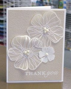 white embossed vellum flowers on gray cardstock...gorgeous!!: