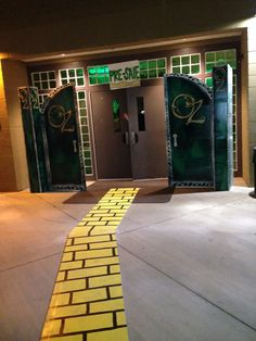 Wizard of oz homecoming spirit week theme with Oz doors and DIY yellow brick road for dance decorations.