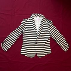 Striped blazer Black and white/cream striped blazer, in great condition! Selling bc I've never worn it and it just hangs in my closet untouched Candie's Jackets & Coats Blazers