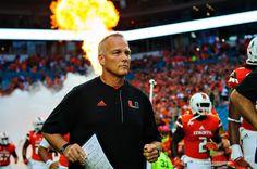 Mark Richt runs through the smoke and fire