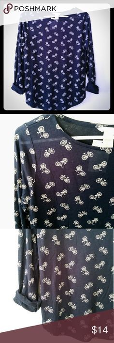 """NWT H&M Navy Blue Novelty Bicycle Print Blouse Top Super cute H&M bicycle print blouse. Navy blue with white bicycles all over the place. New with tags. Sized a small.   34/36"""" bust 24"""" length 24"""" sleeves   I SUPER LOVE novelty prints! More cute items in my other listings! 😘 H&M Tops Blouses"""