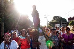 Catholic faithfuls during the procession of the meeting of the godfathers (compadres) where San Andres meets with Santiago Apostol meet each other in the town of A
