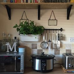 Kitchen organization: Use wall space to hang utensils and free up your counters http://instagram.com/p/tsxz-9A5uG/