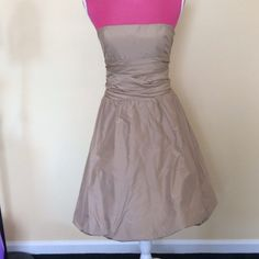 BCBG Maxazria 100% silk gold cocktail dress Just beautiful. BCBG Maxazria strapless gold cocktail dress. Full bottom. Removable belt can be worn tied in front or back. Hidden back zipper. Beautiful condition BCBGMaxAzria Dresses