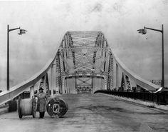 William M. Mott, owner of Mott Electric Co. posing with cable on the deck of the Pattullo Bridge shortly before it opened Nov. Vancouver City, Vancouver Island, Canadian History, Local History, Old Pictures, Old Photos, Fraser River, Historical Pictures, Back In The Day