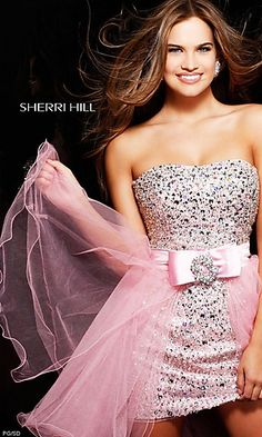 Short Sequin Sherri Hill Prom Dress. Youll sparkle at your next special occasion in this fun and flirty short prom dress by Sherri Hill. This short party dress features a strapless neckline and fitted sheath style short dress that shimmers in silver sequins. A fabulous detachable tulle mini skirt with jewel accented bow lets you change your look from sexy to playful. This stunning short sequin dress would look great at your next prom, homecoming, cocktail or special occasion party.