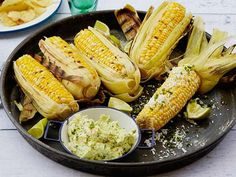 Get this all-star, easy-to-follow Grilled Corn on the Cob with Garlic Butter, Fresh Lime and Cotija Cheese recipe from Bobby Flay