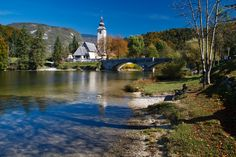 https://flic.kr/p/8LNmfy | A bridge and a church. And a bench to rest. | Lake Bohinj, Slovenia