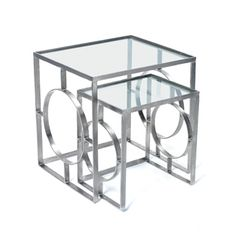 These Hamster Nesting Tables have a symmetrical design with a polished nickel finish and a glass top. Their size make them perfect for when guests are over and you need extra spots to put drinks!