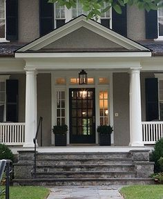 grey house with black shutters and white trim - love the front door and side lights