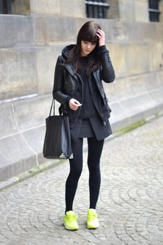 Rock layers: jumper, hoodie and leather jacket. Paired with neon Nike sneakers. All black outfit with neon accents. Via Lovely By Lucy