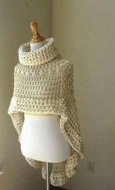 Circle poncho. Like circle shrug with only one slit for head. Asymmetric. Chunky crochet