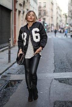 A quilted bomber jacket such as this one from Sheinside is the perfect way to attain the rocker girl look. Camille Callen rocks this edgy tomboy style, pairing the statement bomber with leather leggings and a casual grey tee. Tee: H&M, Bomber Jacket: Shinside, Trousers: Kiabi, Shoes: Topshop, Bag: Chloe.