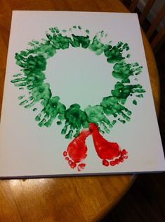Kids Christmas craft (handprints and footprints) Alternate Idea: Veggie Painting. We've used bell peppers for the wreath, carrots for the red berries and hot-glue a velvet bow to the bottom.