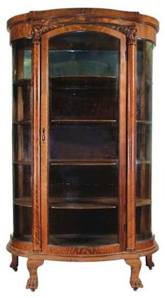 *CHINA CABINET ~ quarter sawn oak with curved glass sides and door, claw feet.
