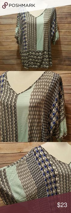 Blue printed blouse Printed blouse.  Blues and creams.  A little mint blue. Dolman sleeves. Size 22/24 Cato Tops