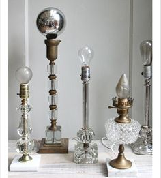 DIY Lights. There's nothing but the pic, but I love the one 2nd from the left with those clear acrylic blocks. Could be a fun take on a chic/clean industrial style lamp.