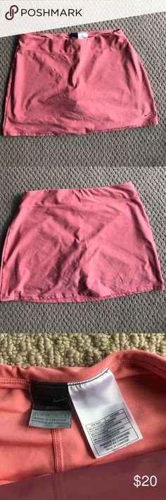 Nike tennis skirt Gently used tennis skirt. Shorts underneath are a good length. Nike Skirts Midi