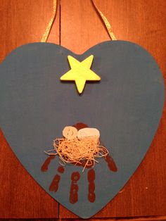 Handprint Manger on heart