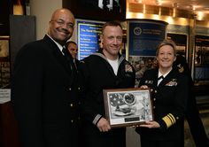2014 Navy Reserve Sailor of the Year, Construction Mechanic 1st Class Jimie Bartholomew, assigned to Naval Mobile Construction Battalion 25, is presented a plaque by Chief of Navy Reserve Vice Adm. Robin Braun and Navy Reserve Force Master Chief C.J. Mitchell at the conclusion of the Reserve Sailor of the Year selection ceremony at the United States Navy Memorial. #AmericasNavy #USNavy #Navy navy.com