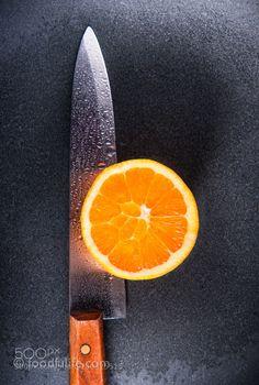 Pic: Orange with kitchen knife