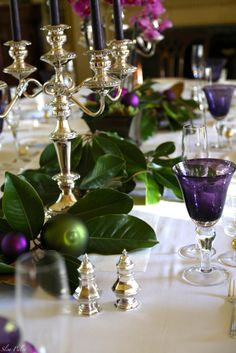Emerald & Amethyst, magnolia leaves for the holiday table Christmas Table Settings, Christmas Tablescapes, Holiday Tables, Christmas Decorations, Table Decorations, Holiday Decor, Christmas Arrangements, Centerpieces, Purple Christmas
