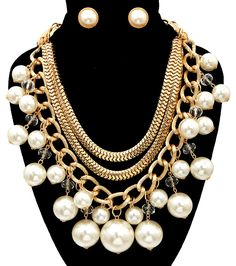 Gold Chain and Cream Pearl Statement Necklace Three rows off gold chains adorned with cream color pearls and clear crystals. Two rows of snake chain and one row loose chain link. Necklace measures 18""