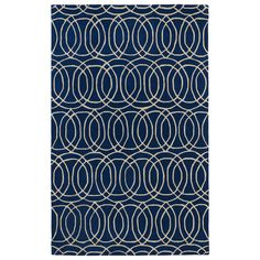 This Cosmopolitan rug brings a trendy pattern and a fashion-forward twist of stylish colors to transform your decor. This wool rug is hand-tufted and hand-carved for added texture while a cotton canvas backing adds extra stability. 736