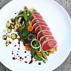 Seared AHI tuna steak, fried Jasmine rice, sesame and ginger roasted vegetables, wasabi pea purée and orange soy glaze by -- -… Seafood Recipes, Gourmet Recipes, Cooking Recipes, Gourmet Desserts, Healthy Cooking, Food Plating Techniques, Wasabi Peas, Seared Ahi, Creative Food
