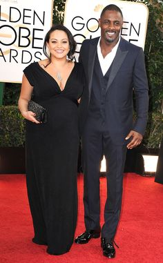 Idris Elba in Gucci at 71st Golden Globe Awards. The navy blue color is something I praised on Elba. The fact that he chose to ignore the last button on top and no tie is something else I am going praise. One word: HOT!